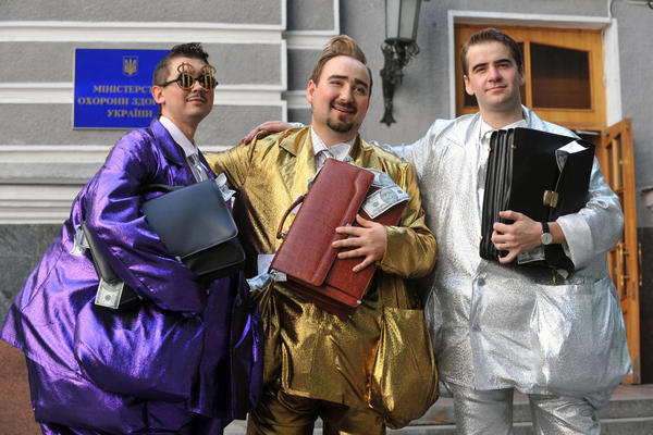 """Fashion designer Oleksiy Zalevsky created """"uniforms for the corrupt"""" during a symbolic fashion show in front of Ukraine's Health Protection Ministry in Kiev in 2009."""