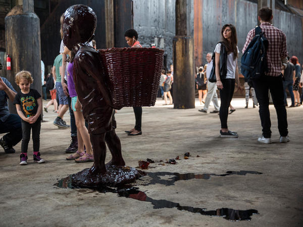 Walker's candy boy sculptures started melting fast in the non-climate-controlled factory, and the result looks a lot like blood.