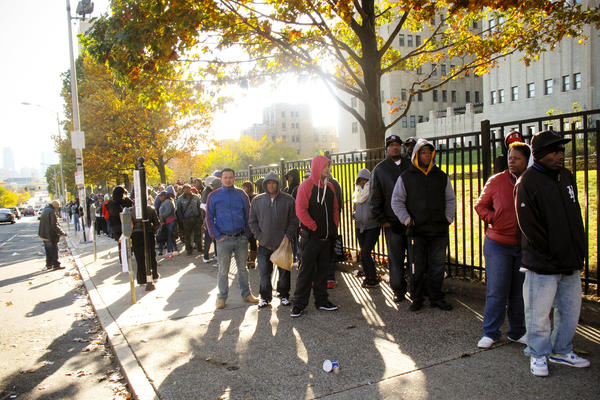 Hundreds of New Jersey residents line up for the state's Fugitive Safe Surrender program. During four days last November, people with unpaid fines and fees were able to get significant reductions.