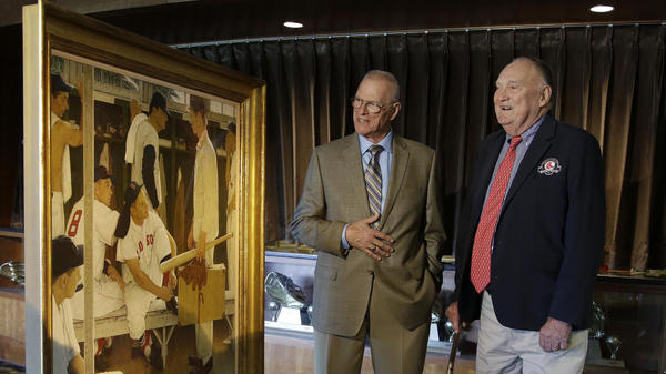 Two of the men who posed for Norman Rockwell's <em>The Rookie</em> — Frank Sullivan (right), the player with 8 on his back in the painting, and Sherman Safford, the rookie holding the suitcase — viewed the work at Fenway Park earlier this month. The painting was sold at auction Thursday.