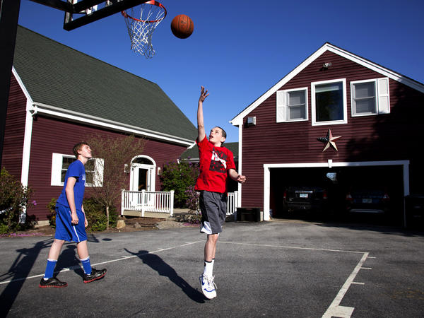 Chandler and Noah shoot hoops. Noah recently went on a school trip to Washington, D.C., without worrying or needing to call back home.