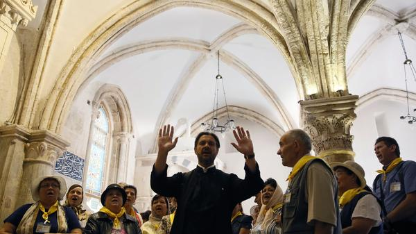 Christian pilgrims from Romania pray at the Cenacle, or Upper Room, on Mount Zion in Jerusalem on May 19. The hotly contested site is holy to Christians, Jews and Muslims, and is where Pope Francis will celebrate Mass on Monday.