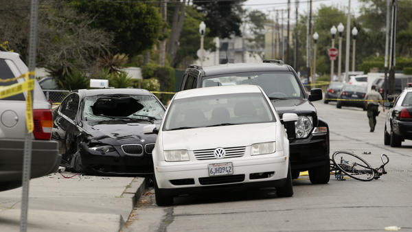 Police tape marks of the scene where a black BMW sedan (left) driven by a drive-by shooter, rests on Saturday The shooter went on a rampage near a Santa Barbara university campus that left seven people dead, including the attacker, and others wounded.