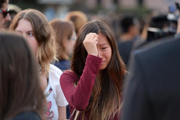 A student weeps during a candlelight vigil on Sunday for the victims of a killing spree in Isla Vista, on the University of California, Santa Barbara campus.