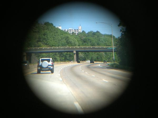A view of Interstate 65 in Alabama through bioptic lenses, which allow people who are severely nearsighted to drive.
