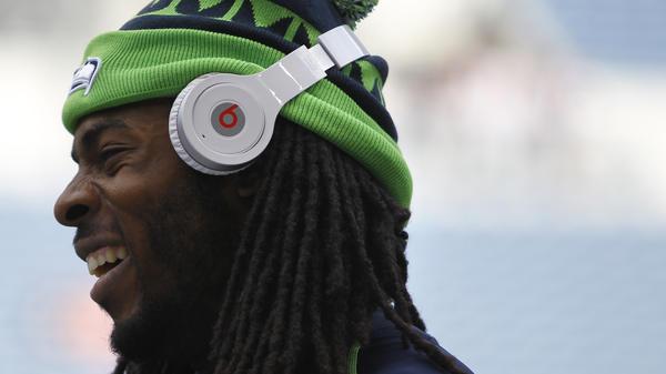 Richard Sherman of the Seattle Seahawks wears Beats headphones before a preseason football game last August.