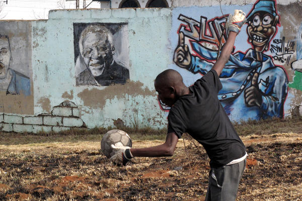 Playing the game in Soweto, South Africa.