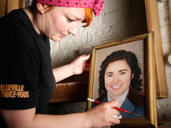 A prop maker readies a portrait of Octavian (Tara Erraught) in advance of the first performance of <em>Der Rosenkavalier </em>at the Glyndebourne Festival last month.