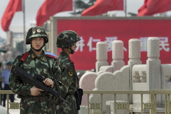 Chinese Paramilitary police stand guard in Tiananmen Square on June 4, 2014 in Beijing, China. Twenty-five years ago on June 4, 1989, Chinese troops cracked down on pro-democracy protesters and in the clashes that followed scores were killed and injured. (Kevin Frayer/Getty Images)