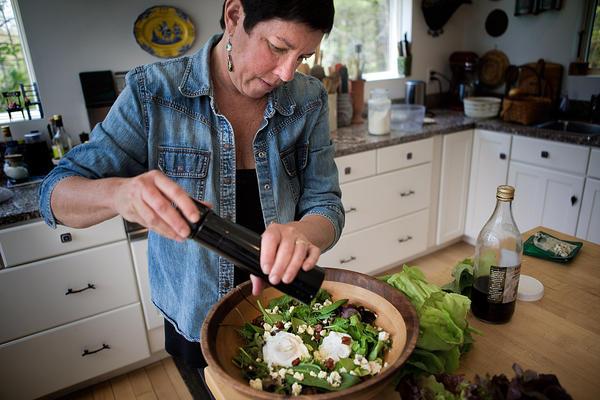 Kathy adds some freshly cracked black pepper. (Jesse Costa/WBUR)