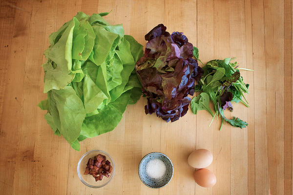 Ingredients for a Bistro-Style Frisée Salad with Spring Ramps. Leafy greens and ramps across the top row, pancetta, sea salt and eggs on the bottom row. (Jesse Costa/WBUR)