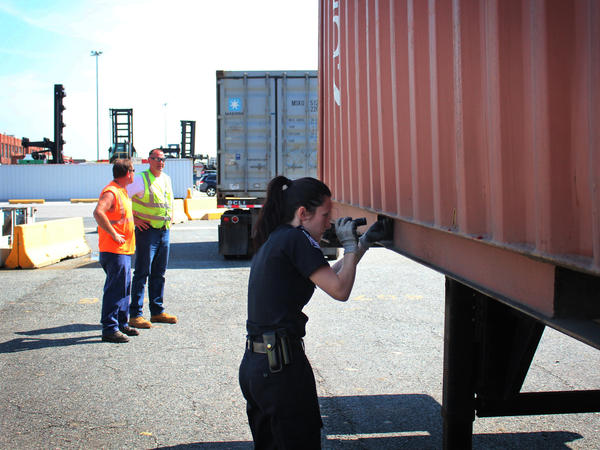 CBP Officer Amanda Furrow searches a shipping container at a Baltimore, Md., port.