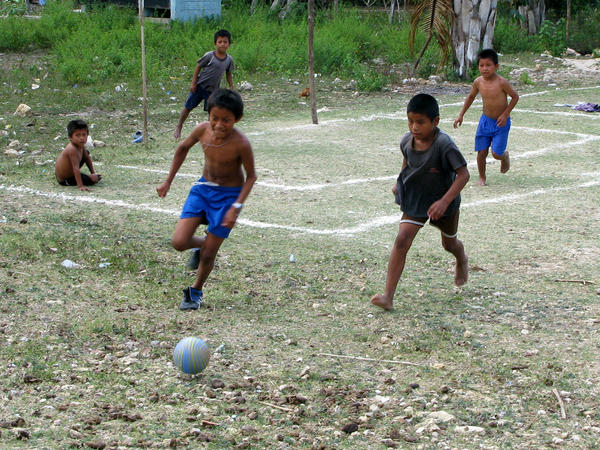 Children play soccer in the village of Limon in the Peten region of northern Guatemala.