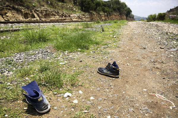 Strewn shoes are commonly found along the tracks outside Huehuetoca. As migrants run alongside the moving trains, they often lose their shoes in the scramble to climb aboard.