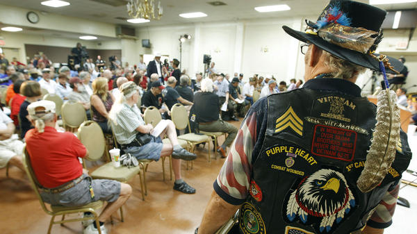 Vietnam veteran Ron Silver Eagle D'Andre (right) attends a town hall meeting at American Legion Post 1 in Phoenix on Monday, concerning health care issues at the Phoenix VA facilities.