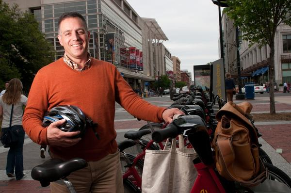 """Carl Cavaliere, a legal assistant, has been a bicycle commuter in Washington, D.C., for 12 years and always wears a helmet. """"You realize how bad the drivers are here,"""" he says."""