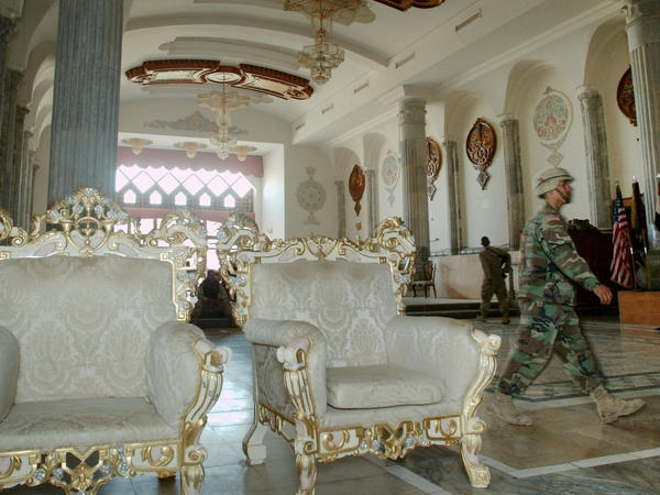 A U.S. soldier walks the halls of an American military base set up in one of Saddam Hussein's former palaces in Tikrit, 2003.
