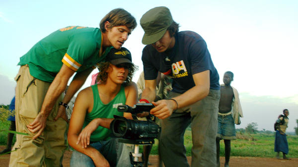 Invisible Children co-founders Jason Russell, left, Bobby Bailey, center, and Laren Poole, record footage in Africa in 2007.
