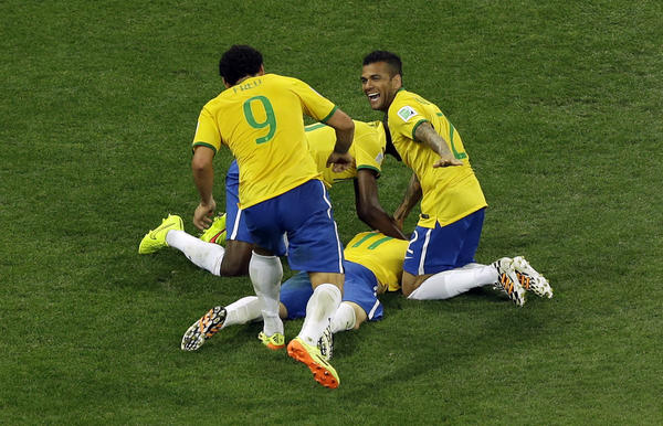 Members of Brazil's national team celebrate after scoring their third goal during the group A World Cup soccer match between Brazil and Croatia on Thursday.