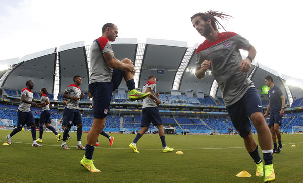 In this photo taken with a fisheye lens, members of the U.S. soccer team warm up during a training session the day before their Group G World Cup match with Ghana in Natal, Brazil.