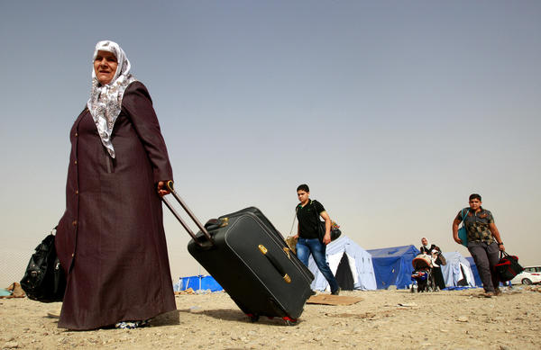 Refugees fleeing from Mosul head to the self-ruled northern Kurdish region in Irbil, Iraq, on June 12.