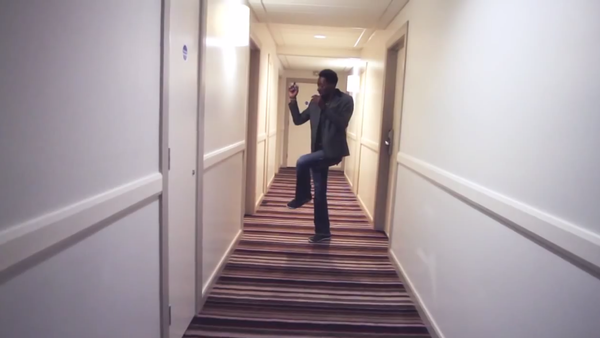 Storyboard P dance down a hall in London.