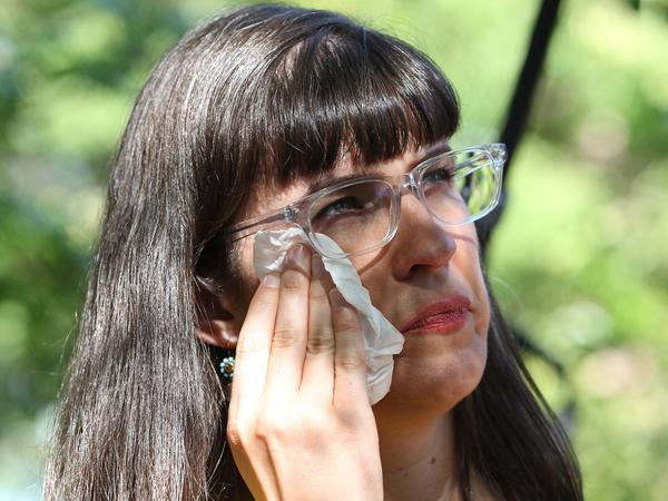 Kate Kelly, a Mormon and founder of Ordain Women, wipes away a tear during a vigil on Sunday in Salt Lake City. Church leaders have ruled to excommunicate her for advocating in favor of female priests.