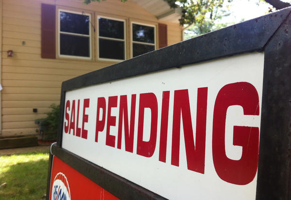 "A ""sale pending"" sign is pictured on a house. (Dan Moyle/Flickr)"