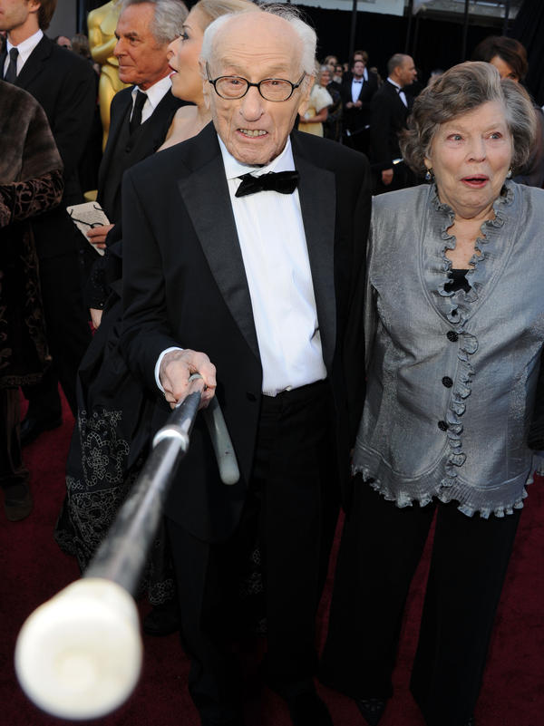 Eli Wallach arrives at the 2011 Academy Awards with his wife, Anne Jackson. Wallach died Tuesday.