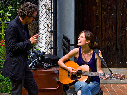 """After hearing Greta singing in a New York City bar, Dan, a record label executive played by Mark Ruffalo in <em>Begin Again</em>, helps her record her first big album. <a href=""""http://www.imdb.com/name/nm0749263/?ref_=tt_cl_t3""""></a>"""