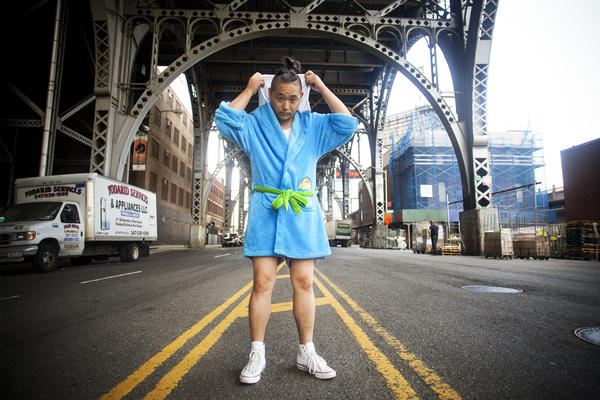 David Lee writes an online men's guide to Asian lifestyle and entertainment. He says he voted against a battle-ax and for his bathrobe when choosing a masculine object. The blue terry cloth robe is based on the <em>Adventure Time</em> cartoon.