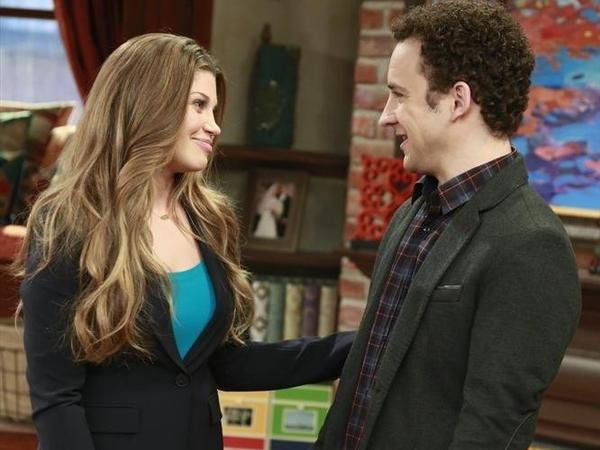 In <em>Girl Meets World</em>, Topanga (Danielle Fishel) and Cory (Ben Savage) have two kids — Riley and Auggie — and Cory teaches history at his daughter's middle school.