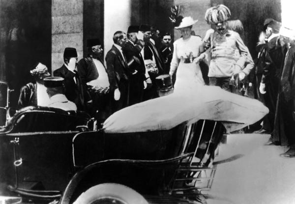 The Austro-Hungarian archduke and his wife, Sophie, board a car just prior to his assassination in Sarajevo.
