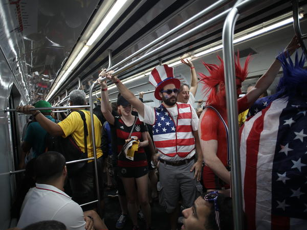 U.S. supporters ride a train to the stadium ahead of the game.