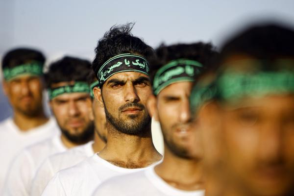 Iraqi Shiite volunteers with the Labayk ya Hussein Brigade take part in a training session in the holy city of Najaf in late June. Clerics in the city called for Shiites to step forward and fight the Sunni group formerly known as the Islamic State of Iraq and Syria (now calling itself simply the Islamic State).