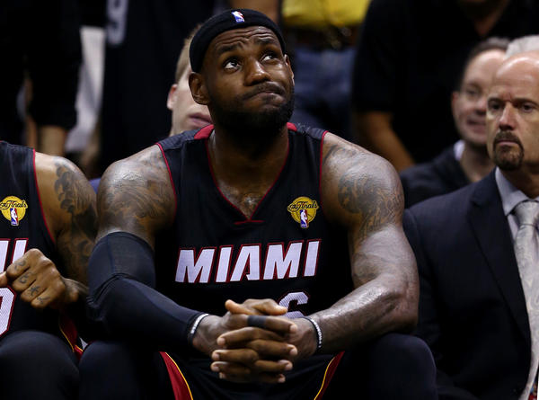 LeBron James of the Miami Heat reacts on the bench against the San Antonio Spurs during Game Five of the 2014 NBA Finals at the AT&T Center on June 15, 2014 in San Antonio, Texas. (Andy Lyons/Getty Images)