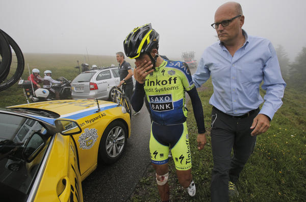 Spain's Alberto Contador abandons the Tour de France after crashing during the 10th stage Monday.