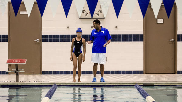 Peri Schiavone, 13, gets some quick notes from her swim coach, Raj Verma, before hopping back into the pool at the Fairfax County YMCA in Reston, Va.