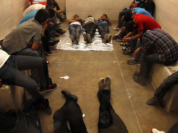 Immigrants who have been detained while crossing the border are held inside the McAllen Border Patrol Station in Texas this week.
