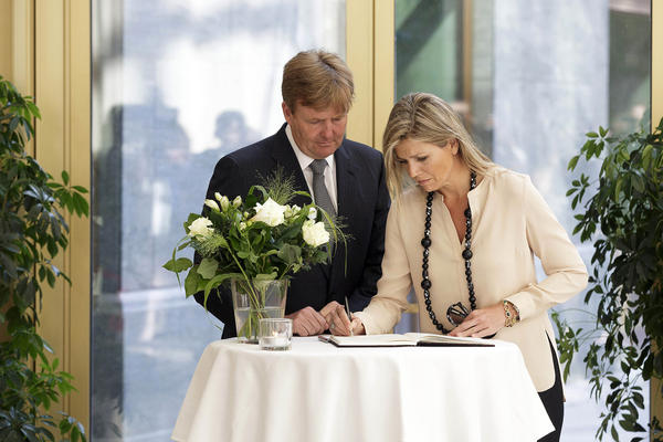 Dutch King Willem-Alexander and Queen Maxima sign a condolence register at the Ministry of Security and Justice in The Hague, Netherlands. More than half of Flight MH17's passengers were from the Netherlands.