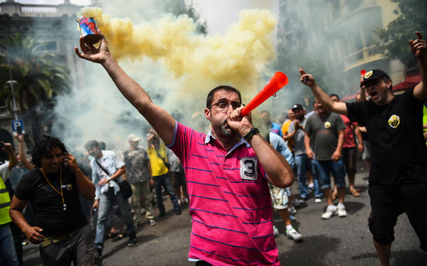 Taxi drivers protest against Uber, an on-demand car service app, during a 24-hour strike July 1 in Barcelona, Spain. They say it undercuts their business and are calling for the government to ban it.