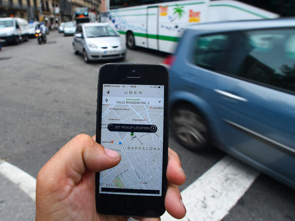 In Spain, taxi licenses can cost upward of $150,000. Drivers pay it off like a mortgage, over their career. Many worry that their investment will be worthless if private citizens can pick up fares with the Uber smartphone app.