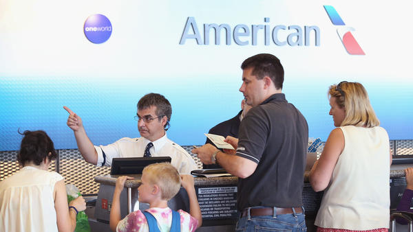 A family checks in for an American Airlines flight at Chicago's O'Hare International Airport
