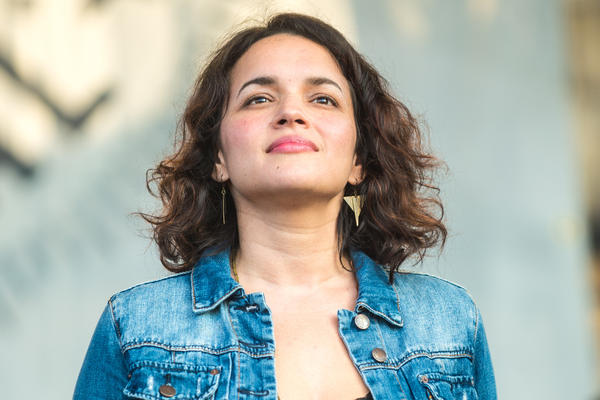Norah Jones, who played on Saturday with her trio Puss n Boots, has now played both the Newport Jazz and Folk Festivals.