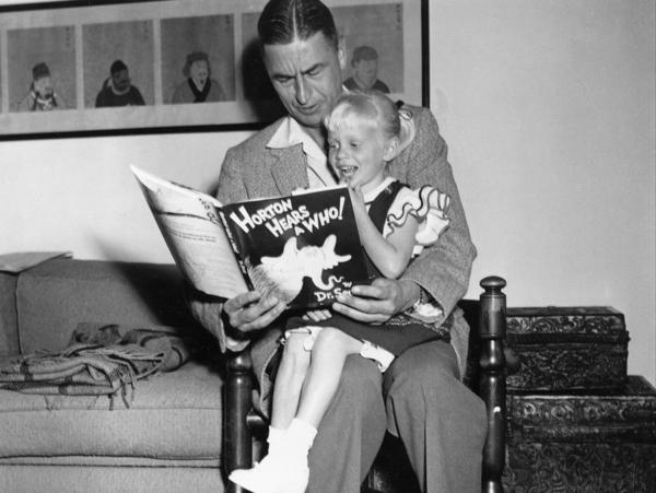 Author and illustrator Theodor Seuss Geisel, known as Dr. Seuss, reads from his book <em>Horton Hears a Who!</em> to 4-year-old Lucinda Bell at his home in La Jolla, Calif., in 1956.