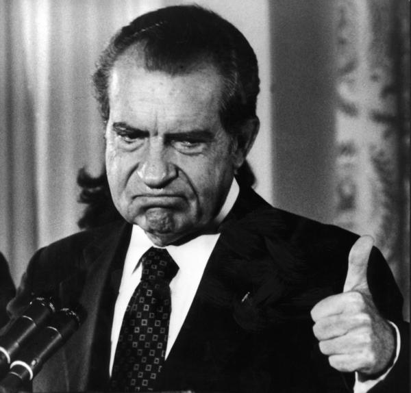 Republican president of the United States Richard Nixon thumbing up after announcing his resignation from the presidency after the Watergate scandal on August 9, 1974. (AFP/Getty Images)
