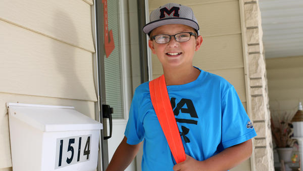 It takes Jaxson Kuhlmann, 11, less than 30 minutes to complete his paper route in Carroll, Iowa. He's paid 10 to 12 cents per copy to deliver the paper five days a week.