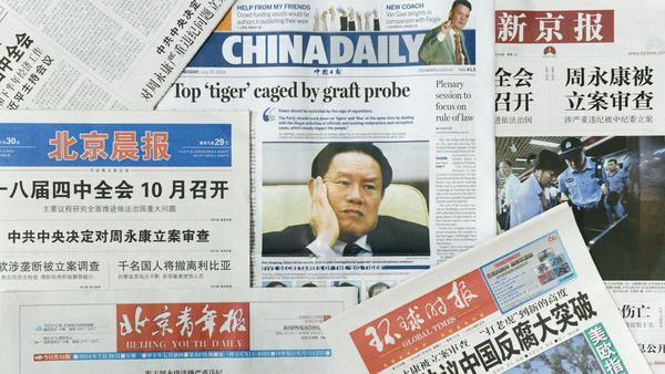Sensational headlines on the front pages of many Chinese newspapers on July 30 reported the Communist Party of China Central Committee's decision to build a case against former security chief Zhou Yongkang for alleged graft.