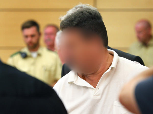 Truck driver Michael Harry K. is brought into a courtroom in the regional court in Wuerzburg, Germany, on Monday. His face is blurred in accordance with German laws.