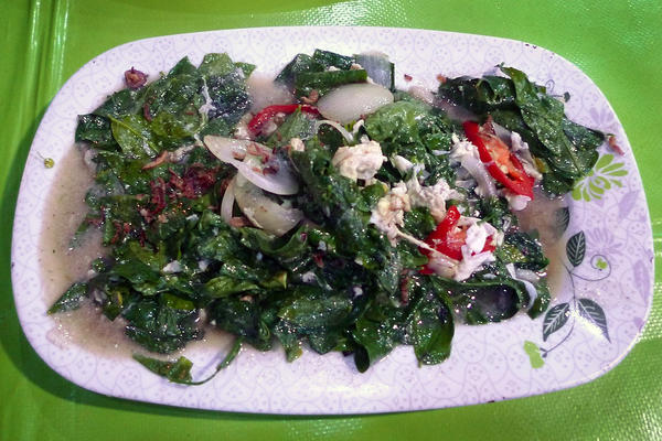 Sayur manis at a restaurant in Kota Kinabalu in Malaysian Borneo. The greens were sautéed with onions, red pepper, dry-fried shallots and egg white.